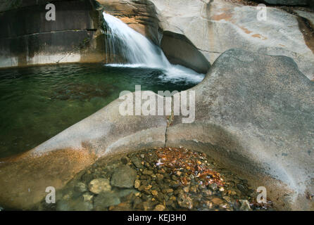 The Basin, striking waterfall and glacier-carved pool, Franconia Notch, White Mountains, New Hampshire - Stock Photo
