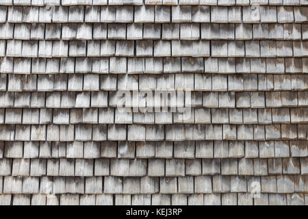 Slate covered wooden wall in Honfleur, France. Grey textured background. - Stock Photo