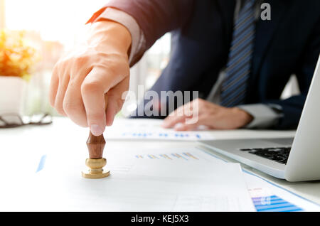 Businessman analysis work approve financial statement. business strategy report finance graph stamp concept analyst - Stock Photo