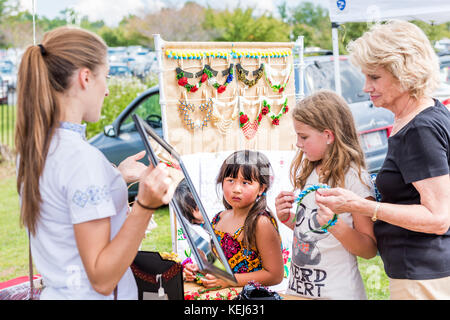 Silver Spring, USA - September 16, 2017: Girls buying Ukrainian slavic beauty bead traditional necklaces, jewelry - Stock Photo