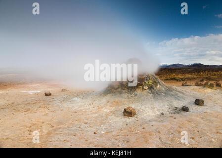Namaskard or Námaskarð geothermal volcanic fumeroles and landscape near Myvatn in northern Iceland - Stock Photo