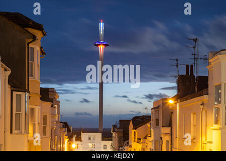 Night falls in Brighton city centre, East Sussex, England. i360 tower in the distance. - Stock Photo