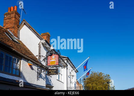 Sign at the historic 15th century Woolpack Hotel in High Street, Tenterden, Kent, southeast England, UK on a sunny - Stock Photo