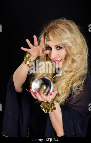 Woman fortune teller with crystal ball portrait - Stock Photo