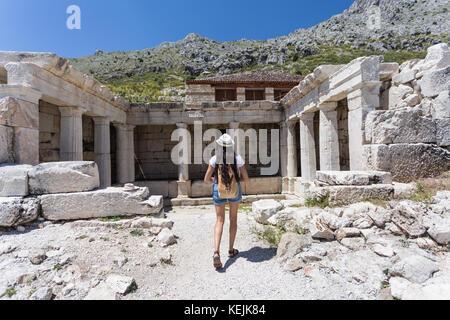 Woman traveller exploring ancient ruins - Stock Photo