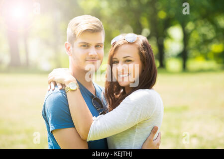 Portrait Of Lovely Couple Hugging Each Other - Stock Photo