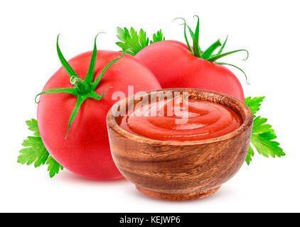 Ketchup in bowl and tomatoes isolated on white - Stock Photo