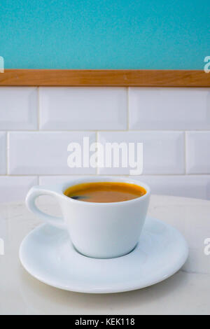 cup of americano coffee ready to serve on the marble table in the coffee shop in the morning. - Stock Photo