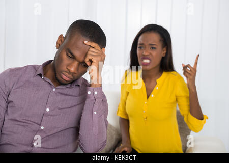 Unhappy Young Woman Having Argument With Man At Home - Stock Photo