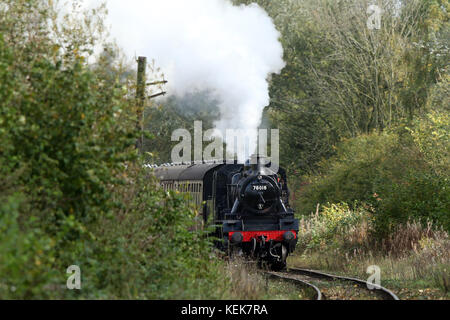 Peterborough, UK. 21st Oct, 2017. A steam locomotive train 78018 powers its way through Nene Park in Peterborough - Stock Photo