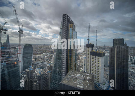 The Gherkin, City of London, UK. 22 October, 2017. Windy day in central London with sunshine and scattered clouds. - Stock Photo