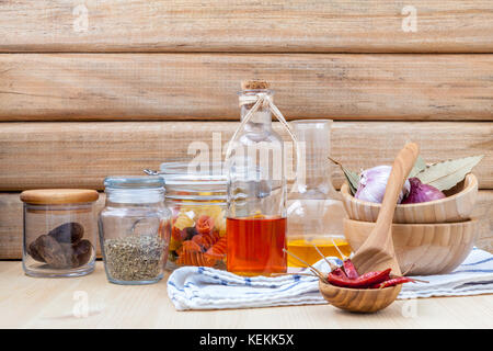 Italian food concept dried pasta with vegetables ,olive oil and spices herbs parsley , basil  and rosemary set up - Stock Photo