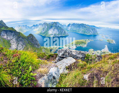 A panorama view of the fishing village of Reine and Lofoten Islands from Reinebringen in Norway - Stock Photo