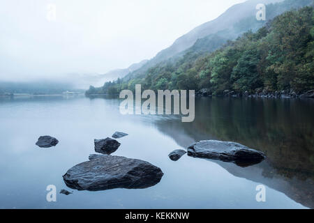 Landscape of Llyn Crafnant during foggy morning in Snowdonia National Park - Stock Photo