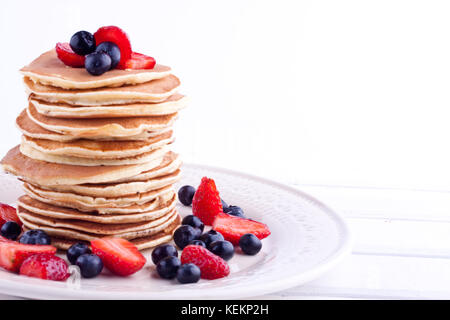 Stack of pancakes with blueberry and strawberry - Stock Photo