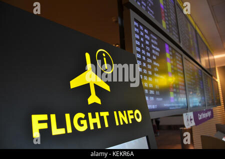 Flight information board in Changi airport Singapore, Asia - Stock Photo