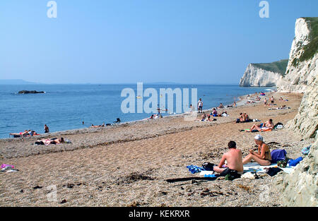 Visitors on beach at Durdle Door, Dorset England. - Stock Photo