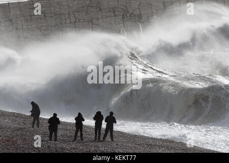 People photographing giant Waves hitting the Newhaven Lighthouse in Sussex on Saturday morning October 21st as Storm - Stock Photo