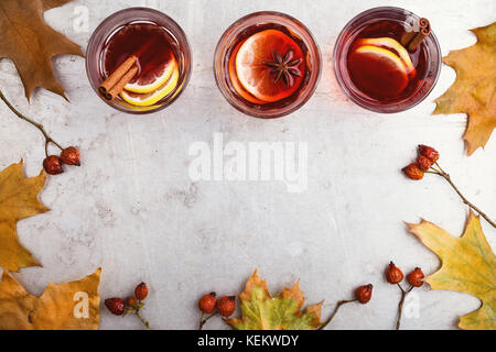 Hot red tea with lemon on light gray table with copy space viewed from above, delicious autumn mulled wine drink - Stock Photo