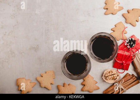Two glasses of black coffee and gingerbread cookies on gray background with copy space viewed from above.  Christmas - Stock Photo