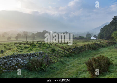 Lake District, Cumbria - a dawn view looking south along St John's in the Vale towards distant Helvellyn, seen from - Stock Photo