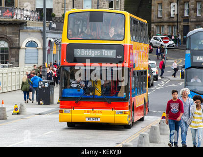 Three Bridges double decker tourist bus arrives at Waverley Bridge in Edinburgh. The new tourist route takes passengers - Stock Photo