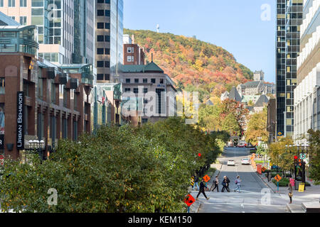Montreal, Canada - 22 October 2017: McGill College Avenue from Place Ville Marie, in Fall, with Mont Royal in the - Stock Photo