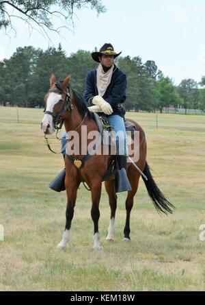 Unidentified Buffalo Soldier Horseback Riding Demonstration in Cheyenne, Wyoming. - Stock Photo