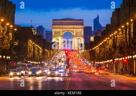 Avenue des Champs Elysees and Arc de Triomphe at night, Paris - Stock Photo