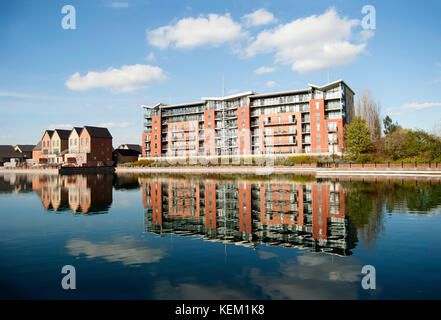 Doncaster lakeside village residential buildings with lake reflections, Doncaster, UK