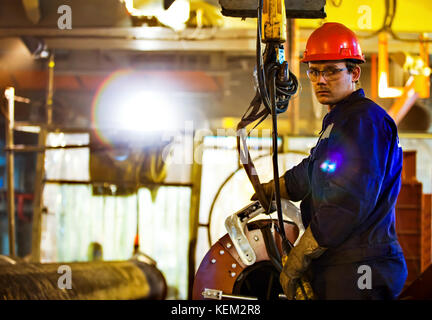 Safety at work. Welding and installation of the pipeline. Industrial weekdays welders and fitters. - Stock Photo