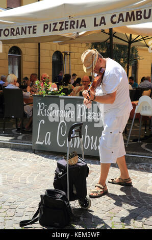 Musician playing in Malcesine, on Lake Garda, in the Lombardy region, in north Italy - Stock Photo
