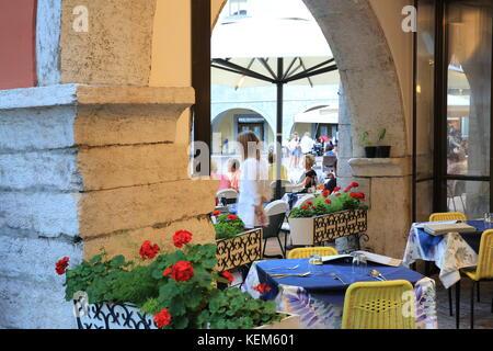 Restaurants in pretty Riva del Garda, on Lake's Garda's shores, in northern Italy, Europe - Stock Photo
