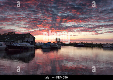 Ludham Bridge, sunrise over the River Ant and Marshes. - Stock Photo