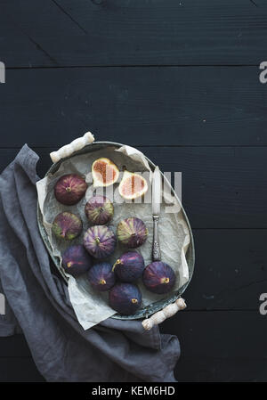 Vintage metal tray of fresh figs on dark background, top view, selective focus. - Stock Photo
