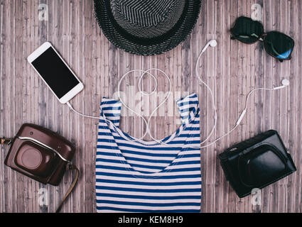Mens casual outfits on wooden background essential vacation item for traveler. Flat lay style. - Stock Photo