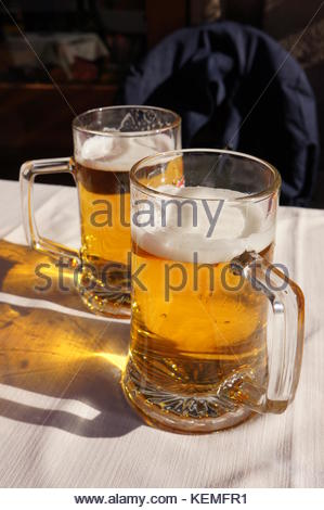 Two big glasses of beer on a sunny day - Stock Photo
