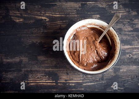 Basic homemade brownie or chocolate cake raw dough in bowl. Cooking (baking) homemade chocolate cake or brownie. - Stock Photo
