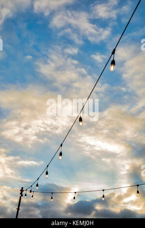 Outdoor string lights at sunset in San Diego, California - Stock Photo