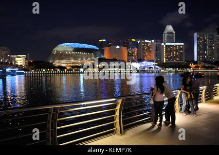 Singapore skyline at twilight seen from Merlion Park SIN - Stock Photo