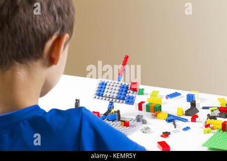 Vilnius, Lithuania - October 15, 2017: Boy playing with lego construction toy blocks. - Stock Photo