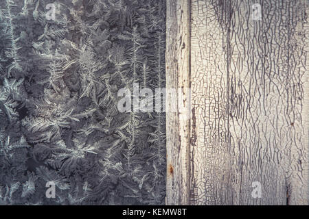 Vintage winter frost background with old wooden bleached surface with frost pattern on frozen window as Christmas - Stock Photo