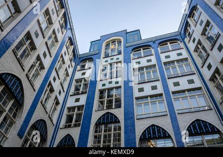 Courtyard space Die Hackeschen Hofe, Berlin, Germany in Jugendstil / Art Nouveau style by August Endel - Stock Photo