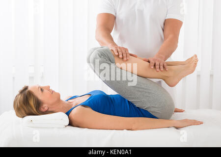 Close-up Of Man Giving Massage To Mature Woman In Spa - Stock Photo