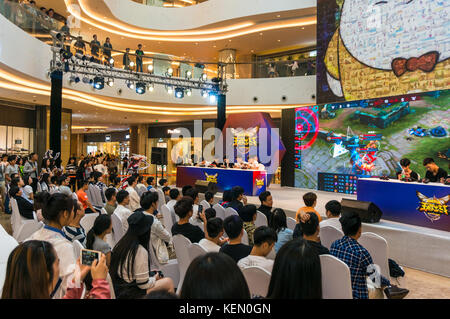 Team mobile video game competition, Kings Smackdown, a League of Legends style game, at a shopping mall in Shenzhen, - Stock Photo