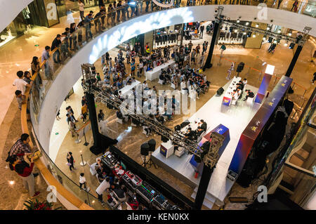 Team mobile phone video game competition at a shopping mall in Shenzhen, China - Stock Photo