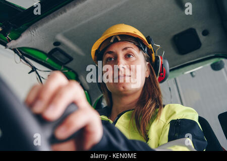 Woman operating heavy equipment - Stock Photo