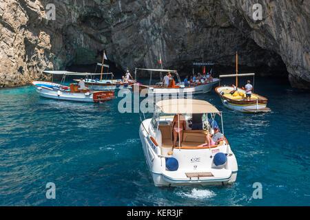 tourists on boat trips visit grotta verda on the island of capri, italy.