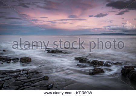 Stunning sunset seascape photograph taken at the heritage coast, Rhoose Point, Vale of Glamorgan in Wales. - Stock Photo
