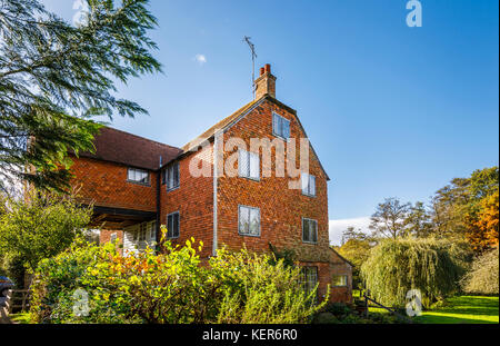 Eighteenth century Shalford Mill, an historic water mill and listed building in Shalford, a village near Guildford, - Stock Photo